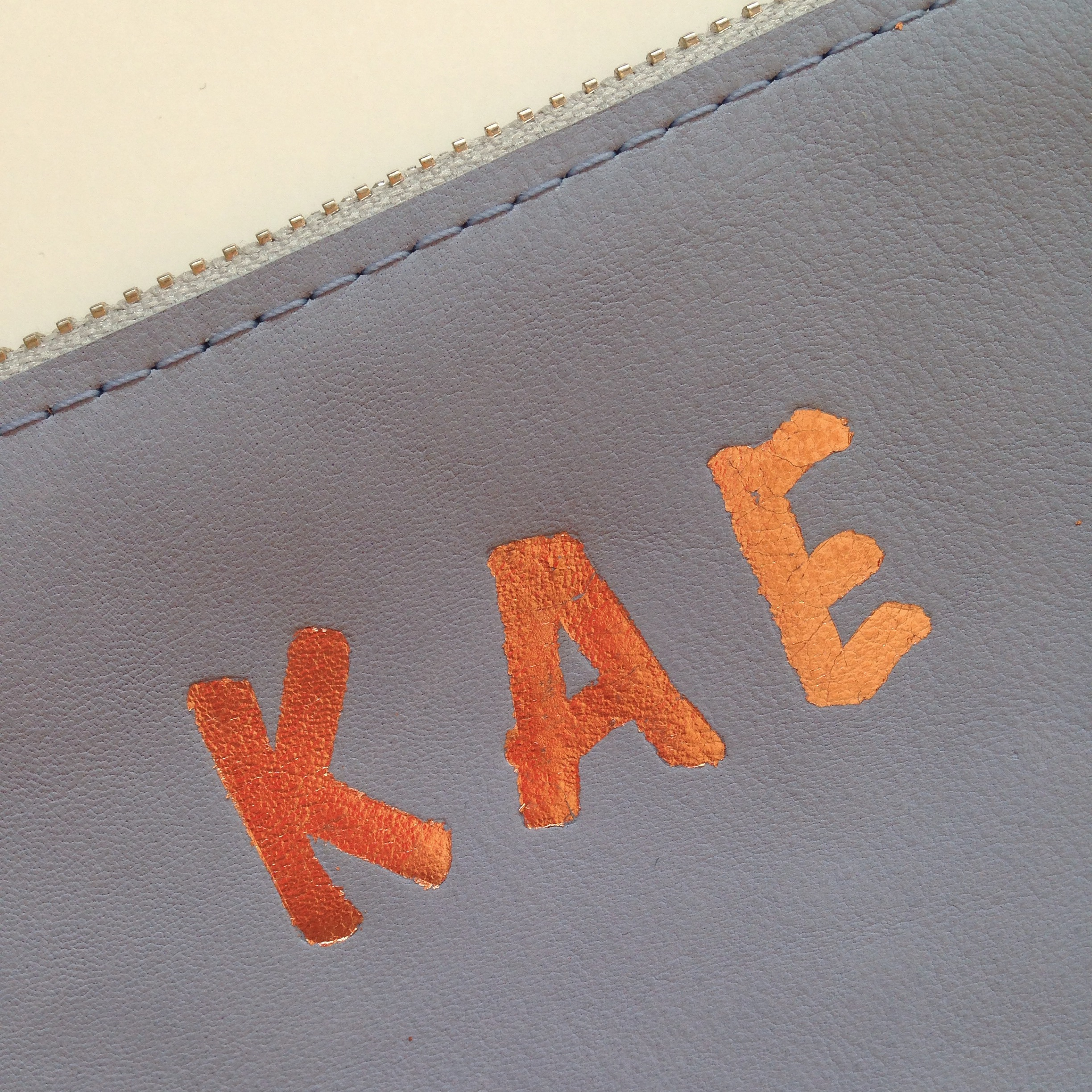 custom gold leaf embossed leather pouch
